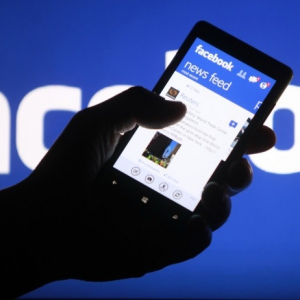 Smartphone user shows facebook application his phone zenica this file photo illustration